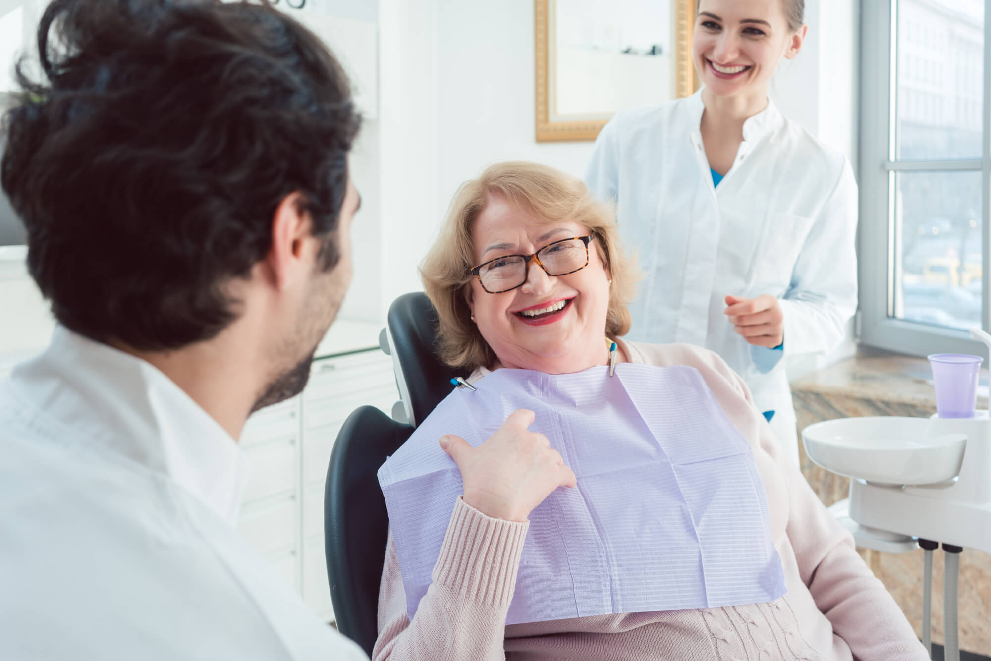 dental experts talk to a patient about dental implants in Pembroke Pines