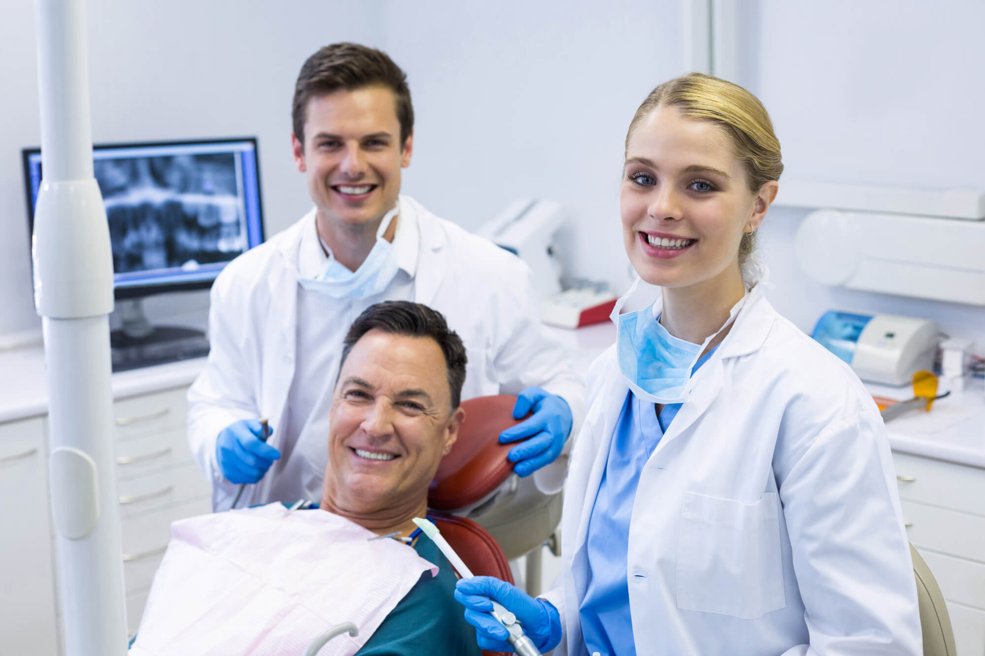 dentists and male patient for Teeth in a day in coral springs