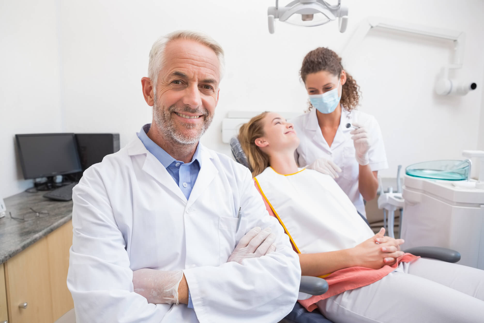 Dentist with assistant and patient after extraction of Wisdom teeth in Plantation