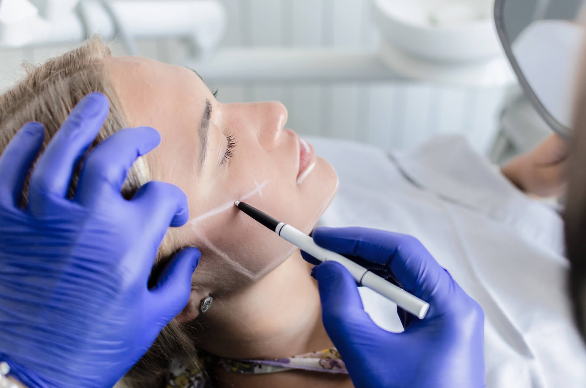 Doctor preparing female patient for Orthognathic Surgery in Plantation